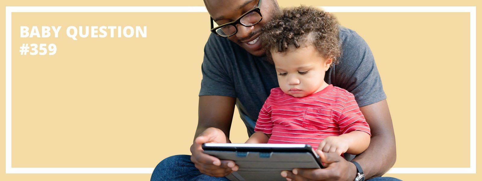 Father with baby looking at digital tablet
