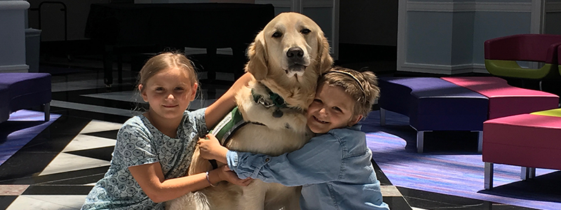 Two girls with therapy dog