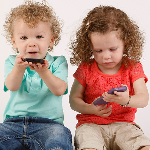 Kids on tablet and cellphone