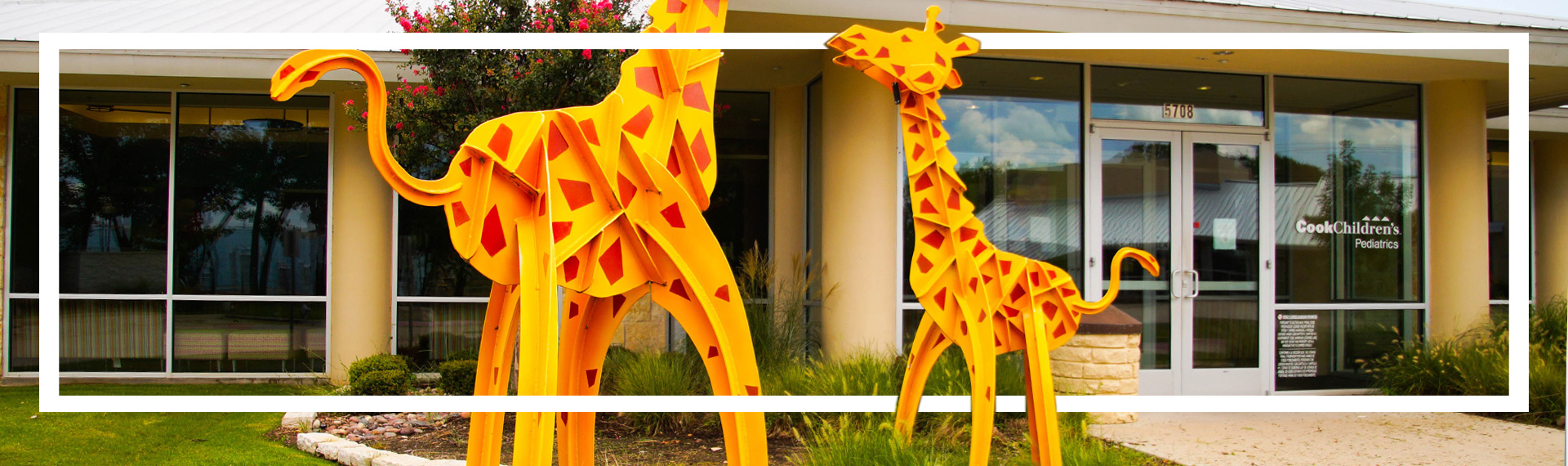 Exterior of clinic showing giraffe sculptures