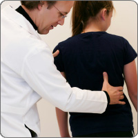 Doctor examining patient's back alignment
