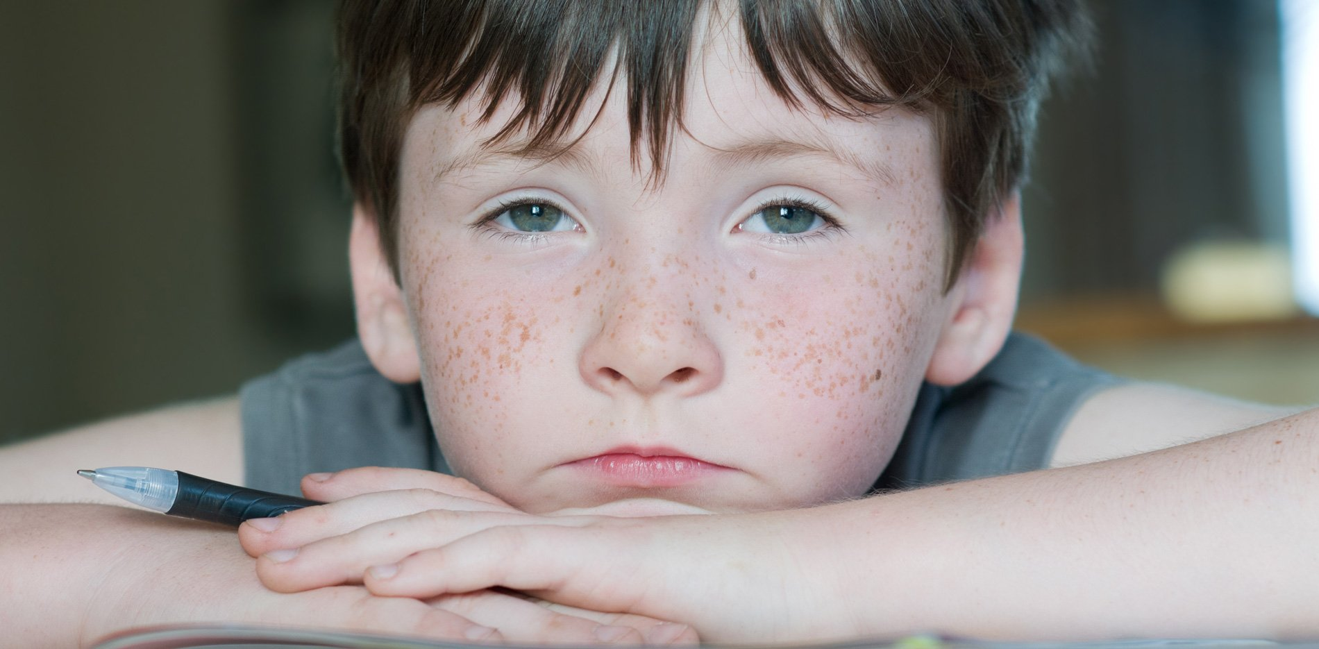 Freckled boy with pensive look