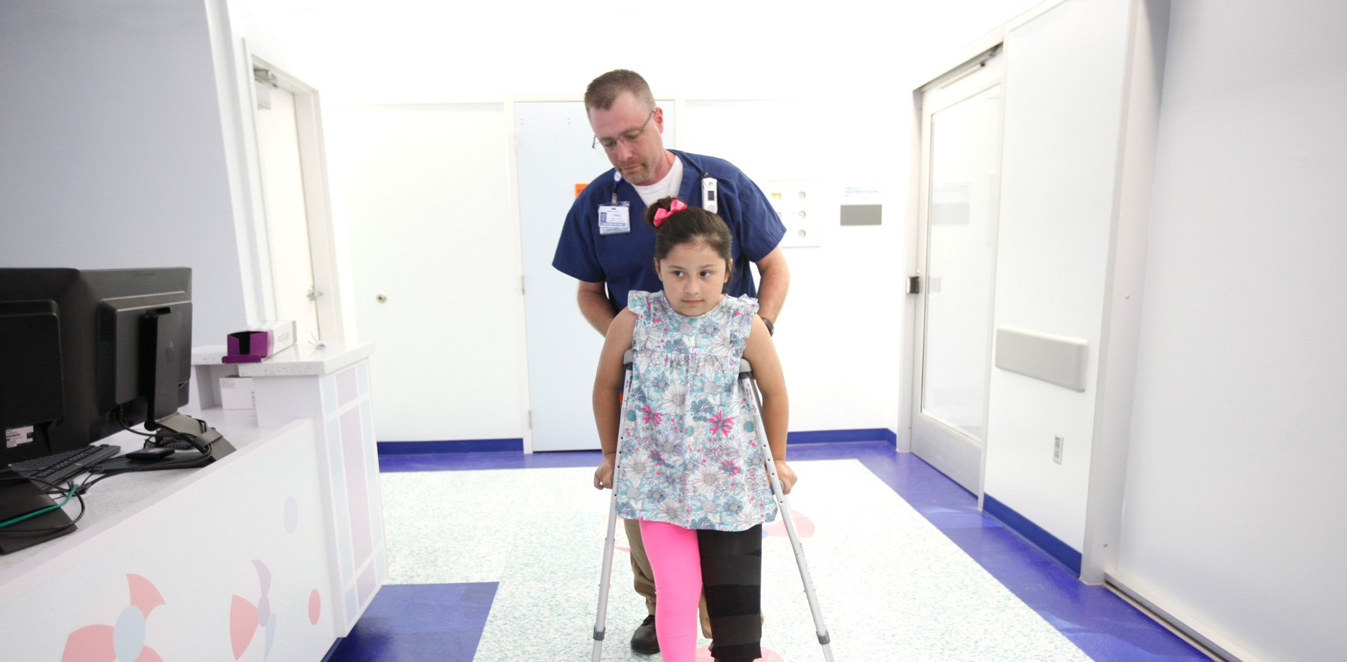 Patient on crutches with doctor